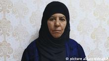 HANDOUT - 05.11.2019, ---: Rasmija Awad, Schwester des getöteten Chefs der Terrormiliz Islamischer Staat (IS), Abu Bakr al-Bagdadi, steht an einer Wand (undatiertes Foto). Die Türkei hat sie nach eigenen Angaben mit ihrem Ehemann, ihrer Schwiegertochter und fünf Kindern im nordsyrischen Asas festgesetzt. Die Erwachsenen würden in Asas verhört. Foto: AP/dpa - ACHTUNG: Nur zur redaktionellen Verwendung im Zusammenhang mit der aktuellen Berichterstattung +++ dpa-Bildfunk +++  