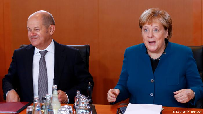 Finance Minister Olaf Scholz and Chancellor Angela Merkel