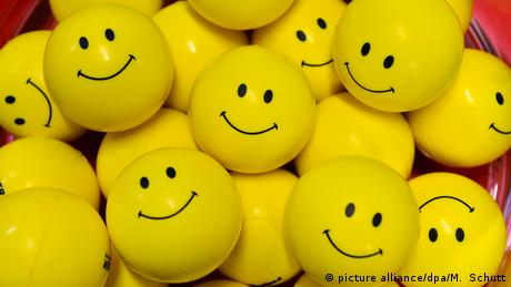 A bunch of anti-stress balls with smiley faces on them.