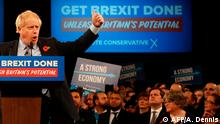 Britain's Prime Minister Boris Johnson speaks at the Conservative Party's General Election campaign launch, at the National Exhibition Centre (NEC) in Birmingham, central England, on November 6, 2019. - British Prime Minister Boris Johnson vowed Wednesday to get Brexit done by January and compared his Labour Party rival Jeremy Corbyn to Joseph Stalin in a strident launch to a tough pre-Christmas election campaign. The splintered country is entering its third general election in four years in search of a solution to a monumental crisis launched by the voters' decision in 2016 to file for a divorce from the European Union after nearly 50 years. (Photo by Adrian DENNIS / AFP)