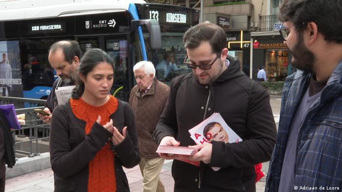 Miguel Angel Goni hands out campaign flyers on a Madrid street
