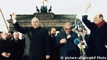 FILE - In this Dec. 22. 1989, file photo, West German chancellor Helmut Kohl, left, waves as he stands together with then East German Prime Minister Hans Modrow, second right, in front of the Brandenburg Gate during the opening ceremony of the Berlin Wall, Dec. 22. 1989. The abrupt fall of the Wall in 1989 and lightning speed that reunification took place took everyone by surprise at the time and was a shock to the system for some 16 million East Germans. Unrealistic expectations combined with other factors have helped lead to today's discontent, providing fertile ground for the far-right. (AP Photo/File) |
