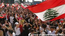 Student protesters wave their national flags as they protest against the government in front of the education ministry in Beirut, Lebanon, Thursday, Nov. 7, 2019. Lebanese protesters are rallying outside state institutions and ministries to keep up the pressure on officials to form a new government to deal with the country's economic crisis. (AP Photo/Hussein Malla) |