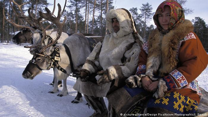 band And Wife From Khanty Tribe And Reindeer, In The Snow.