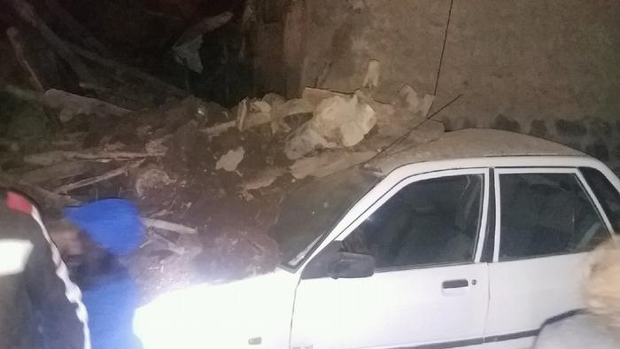 Car damaged by rubble