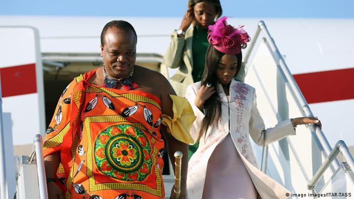 King Mswati III of Eswatini disembarks from a plane
