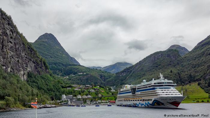 A cruise ship in a Norwegian fjord
