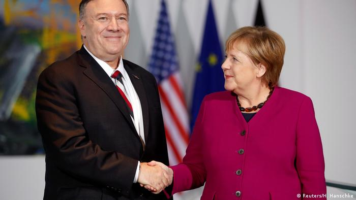Pompeo and Merkel shake hands (Reuters/H. Hanschke)