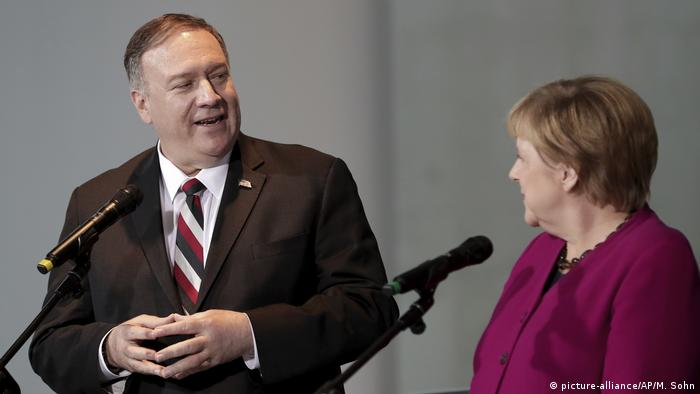Mike Pompeo gives a press conference with Merkel in Berlin