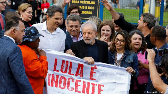 Lula Da Silva holds a sign which reads Lula is innocent