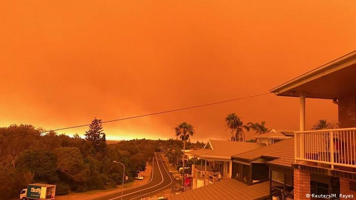 Bushfires turn the sky orange in Port Macquarie.