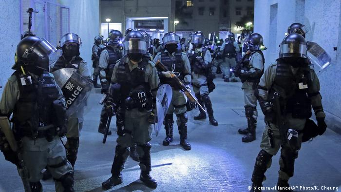 Police officers at a housing estate after clashing with protesters in Hong Kong