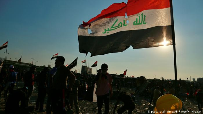 Anti-government protesters gather near the Tigris River during ongoing protests in Baghdad, Iraq