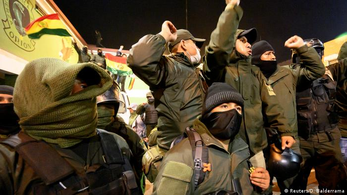 Bolivia police officers join anti-government protests