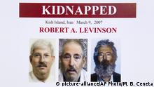FILE- In this March 6, 2012 file photo, an FBI poster showing a composite image of former FBI agent Robert Levinson, right, of how he would look like now after five years in captivity, and an image, center, taken from the video, released by his kidnappers, and a picture before he was kidnapped, left, displayed during a news conference in Washington. It's been 10 years since former FBI agent Robert Levinson disappeared while in Iran on an unauthorized CIA mission and his family is still waiting for answers. His family tells The Associated Press they hope the new administration of President Donald Trump will do more to find him. (AP Photo/Manuel Balce Ceneta, File) |