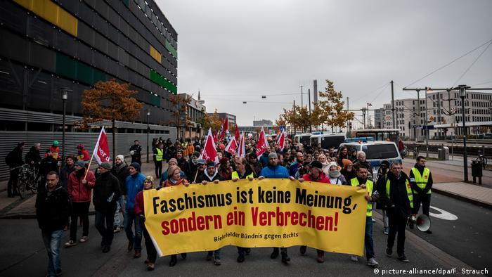 Protesters demonstrating against a neo-Nazi march in Bielefeld carry a banner reading: Fascism is not an opinion, it's a crime