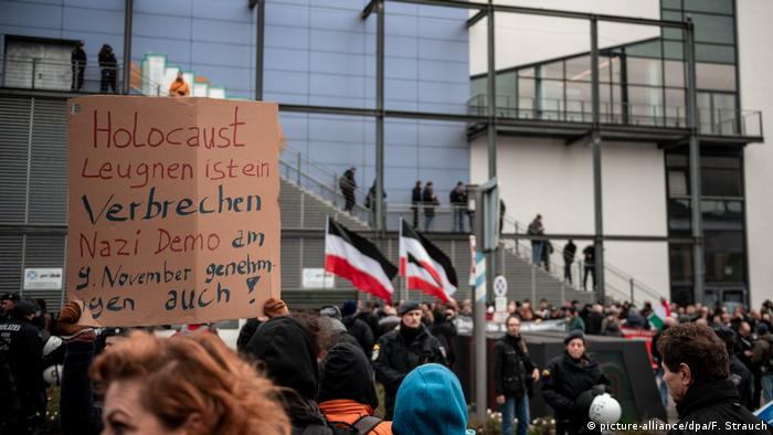 Holocaust denial is a crime. Approving a Nazi demonstration on November 9 is too! wrote one counterprotester at a demonstration in Bielefeld, Germany