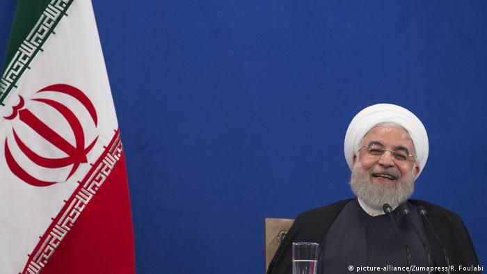 Hassan Rouhani laughing