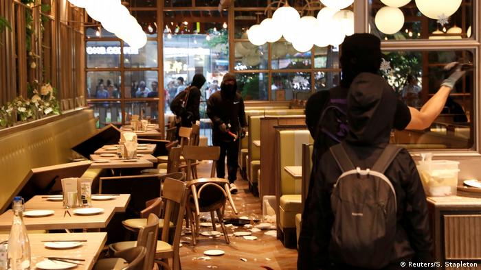 Protesters vandalizing a restaurant in Tsuen Wan (Reuters/S. Stapleton)