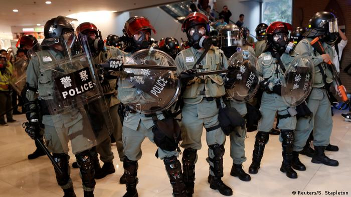 Hong Kong police with shields and truncheons
