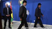 Bolivia's President Evo Morales, center, leaves at the end of a press conference, accompanied by his Vice President Alvaro Garcia Linera, left, and Foreign Minister Diego Pary, at the military airport in El Alto, Bolivia, Saturday, Nov. 9, 2019. Police in three of the most important cities of Bolivia retreated to their barracks asking for the resignation of Morales called for a dialogue with the opposition to pacify the country after weeks of protests against the results of the presidential elections. (AP Photo/Juan Karita) |