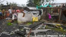 Villagers clear debris from their homes damaged by Cyclone Bulbul in Bakkhali on November 10, 2019. - Three people have died and two million others spent a night huddled in storm shelters as Cyclone Bulbul smashed into the coasts of India and Bangladesh with fierce gales and torrential rains, officials said on November 10. (Photo by Dibyangshu SARKAR / AFP) (Photo by DIBYANGSHU SARKAR/AFP via Getty Images)
