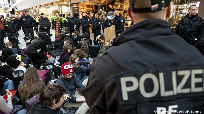 Police surround climate protesters staging a sit-in at Berlin's Tegel Airport