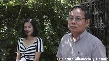 Pheng Heng, right, lawyer to former Cambodia National Rescue Party's President Kem Sokha, speaks to media in front of Kem Sokha's house in Phnom Penh, Cambodia, Sunday, Nov. 10, 2019. A Cambodian court has lifted some restrictions on detained opposition leader Kem Sokha, essentially ending his house arrest. (AP Photo/Heng Sinith) |