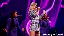 US singer Taylor Swift (C) performs during the 2019 Tmall 11:11 Global Shopping Festival gala in Shanghai on November 10, 2019. (Photo by STR / AFP) / China OUT (Photo by STR/AFP via Getty Images)