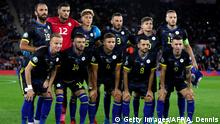 Kosovo players, back row (LtoR), Kosovo's forward Vedat Muriqi, Kosovo's goalkeeper Arijanet Muric, Kosovo's defender Mergim Vojvoda, Kosovo's defender Fidan Aliti, Kosovo's midfielder Florent Muslija and Kosovo's defender Amir Rrahmani, and front row (LtoR), Kosovo's defender Florent Hadergjonaj, Kosovo's midfielder Valon Berisha, Kosovo's midfielder Idriz Voca, Kosovo's midfielder Besar Halimi and Kosovo's forward Bersant Celina pose for a team photograph ahead of the UEFA Euro 2020 qualifying Group A football match between England and Kosovo at St Mary's stadium in Southampton, southern England on September 10, 2019. (Photo by Adrian DENNIS / AFP) / NOT FOR MARKETING OR ADVERTISING USE / RESTRICTED TO EDITORIAL USE (Photo credit should read ADRIAN DENNIS/AFP via Getty Images)