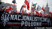 Marchers in Warsaw with a banner (Reuters/K. Pempel)