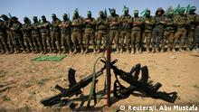 Hamas militants pray during an anti-Israel military show in the southern Gaza Strip in 2019