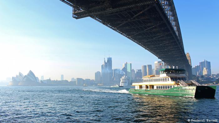 A ferry navigates smoke-filled Sydney