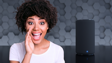 Young woman next to Smart Speaker