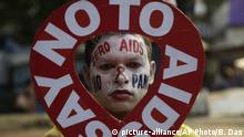 An activist holds a placard in the shape of the red ribbon, the universal symbol of awareness and support for those living with HIV, during an awareness campaign ahead of World AIDS Day in Kolkata, India, Friday, Nov. 30, 2018. World AIDS Day falls on Dec. 1. (AP Photo/Bikas Das) |