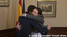 12.11.2019 *** Spain's caretaker Prime Minister Pedro Sanchez, left, and Podemos party leader Pablo Iglesias hug after signing an agreement at the parliament in Madrid, Spain, Tuesday, Nov. 12, 2019.The leaders of Spain's Socialist party and the left-wing United We Can (Podemos) party say they have reached a preliminary agreement toward forming a coalition government. But the deal announced Tuesday won't provide enough votes in parliament for the Socialists, who won a general election, to take office without the support of other parties. (AP Photo/Paul White) |