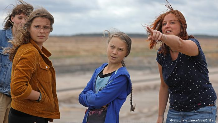 Luisa Neubauer and Greta Thunberg visit a brown coal plant in Germany
