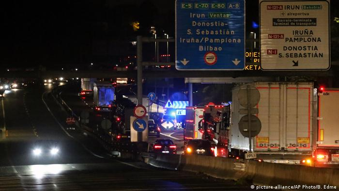 Trucks are seen on the highway between France and Spain following a highway blockade by Catalan activists