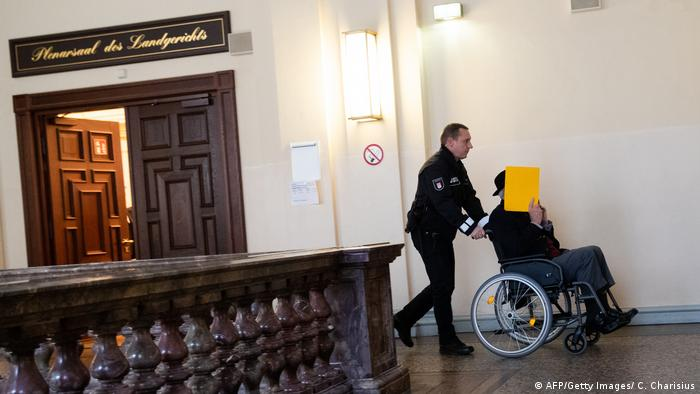Former SS guard Bruno D. leaves court in a wheelchair
