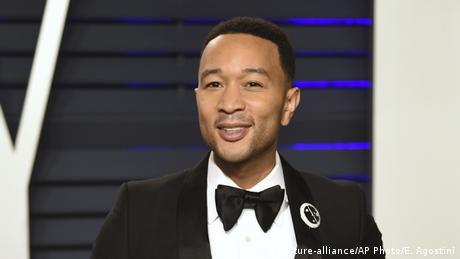 A portrait of John Legend wearing a suit. USA | Musician John Legend