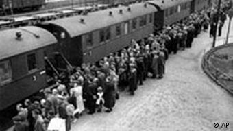 Sudeten Germans wait to board a train to take them out of Czechoslovakia