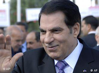 Tunisian President Zine El Abidine Ben Ali waves as he arrives to a meeting marking the 21st anniversary of his access to power,in Tunis, Friday Nov. 7, 2008. (AP Photo/Hassene Dridi)