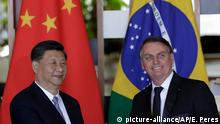 China's President Xi Jinping, left, and Brazil's President Jair Bolsonaro, smile after delivering their statements during a bilateral meeting on the sidelines of the 11th edition of the BRICS Summit, at the Itamaraty Palace, in Brasília, Brazil, Wednesday, Nov. 13, 2019. (AP Photo/Eraldo Peres)