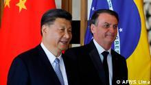 Os presidentes Xi Jinping e Jair Bolsonaro em encontro do Brics em Brasília, em novembro de 2019
