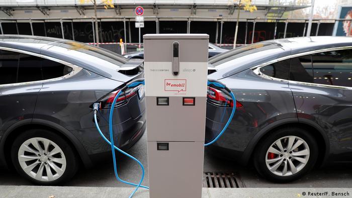 Two tesla cars charging