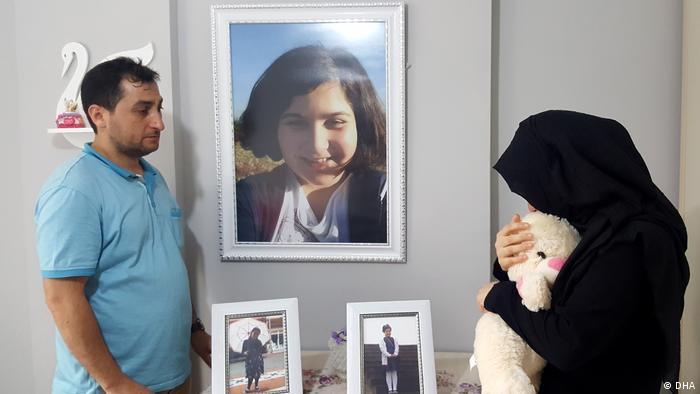 Saban Vatan stands next to pictures of his daughter