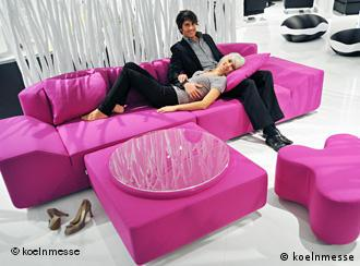 A bright pink couch at the Cologne furniture fair