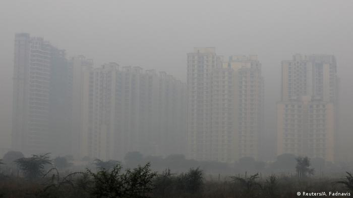 Smog blocks out a view of tower blocks in New Delhi