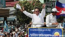 FILE - In this June 2, 2017, file photo, opposition party Cambodia National Rescue Party (CNRP) leader Kem Sokha greets his supporters at a rally in Phnom Penh. The government accuses the Cambodia National Rescue Party of involvement in a plot to topple the government and has asked the judiciary to dissolve it. CNRP officials have denied the charges, saying they are politically motivated. (AP Photo/Heng Sinith, File) |