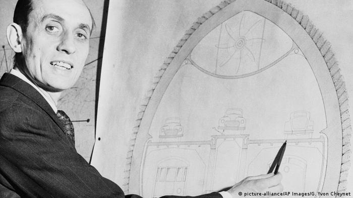 Andre Basdevant, designer of the proposed Channel Tunnel, seen in his Paris office in 1949, with his tunnel design.
